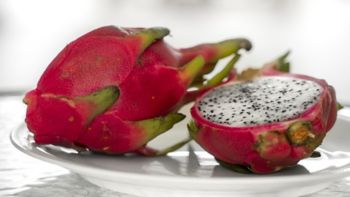 Dragon fruit. Vibrant Dragon Fruit on white background. Sliced white dragon fruit or pitaya on white plate on the table, close-up. Tropical and exotic fruits. Healthy and vitamin food concept.