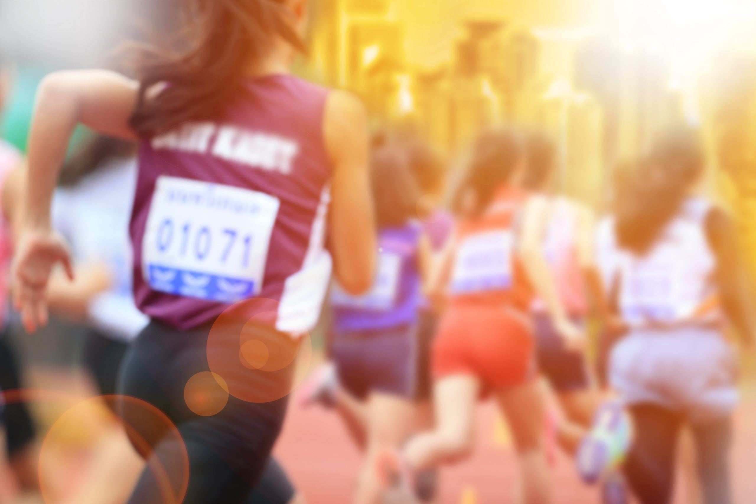 Blurred image of women marathon racing in the city with lans flare.; Shutterstock ID 556077157; Purchase Order: Informed Choice Fact Sheet; Job: ; Client/Licensee: ; Other:
