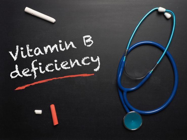 Blackboard with the words Vitamin B deficiency and a stethoscope, medical or health care concept